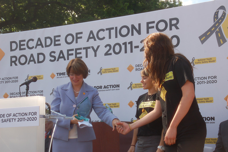 NOYS student leaders presenting a safety award to Senator Amy Klobuchar (D-MN)