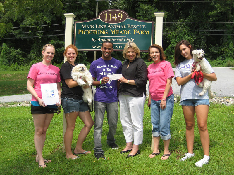 Tricia (left) and Kaitlyn (Phi Sigma Pi brothers), Teric, Vice President Phi Sigma Pi (2010-1011 school year); Lauren Christiansen, Director of Development, Main Line Animal Rescue; Dianne Anderson Feldman (Casey's mother and officer of the Casey Feldman Memorial Foundation and Alicia Green, Phi Sigma Pi brother.