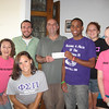 "Dianne Anderson (a/k/a Mrs Feldman, left); Robbie, Assistant Director, Sarnelli House; Father Kevin Murray, Director, Sarnelli House; Teric, Vice President Phi Sigma Pi (2010-1011 school year); Kaitlyn and Tricia, Fraternity ""brothers"" and Alicia (front), Fraternity brother"