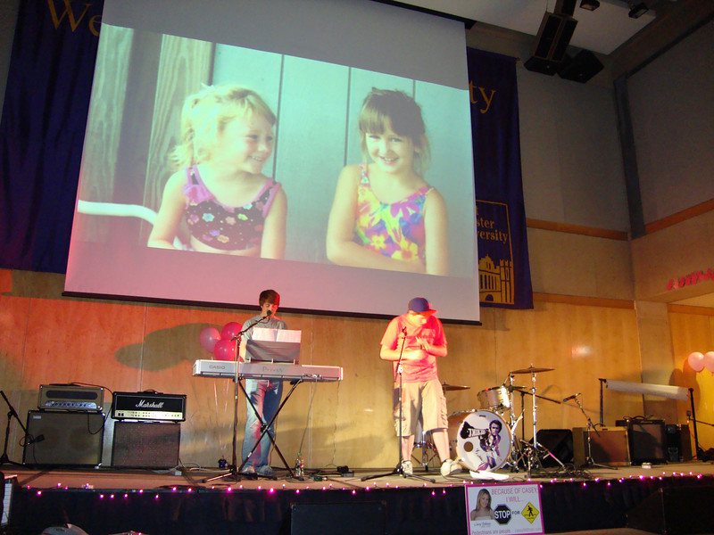 Casey and her cousin Jamie in Sea Isle City on the screen as the musicians play.