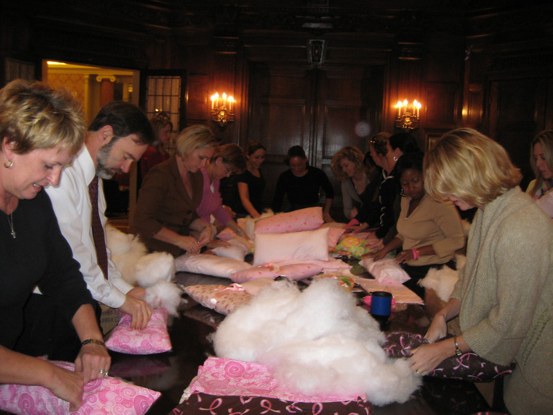 Members of the Anapol staff making pillows.