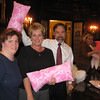 Rita Cancelliere (left), coordinator for the project with ? (center) and Joel, displaying pillows.