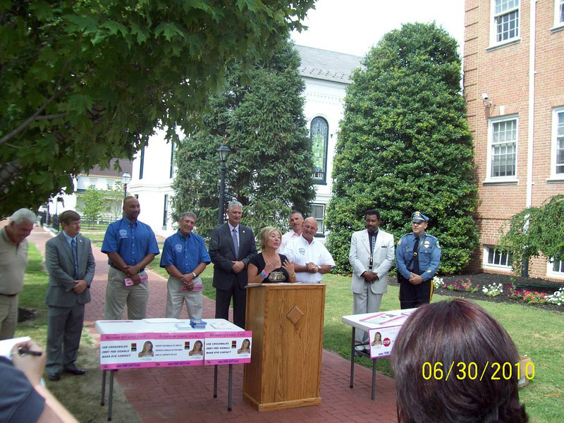 Casey's Aunt, Janice Gallagher, addresses the crowd on behalf of Casey's family.<br /> <br /> L: Freeholders Ben Laury and Dale Cross, Freeholder Director Lee Ware, Sheriff Chuck Miller, Dept Dir David Lindenmuth (back), Freeholder Bruce Bobbit, Rev. Fields, Salem City Police Chief John Pelura