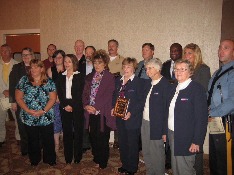 Award recipients. Dianne Anderson (2nd from left, front row), Joel Feldman (behind and to the right of Dianne)