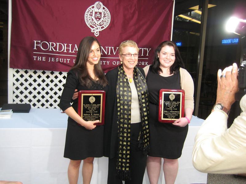 Katie Feeney, Dr. Elizbeth Stone and Ashley Wennersherron. Dr. Stone presented Katie and Ashley with The Journalism Awards.