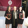 Katie Feeney, Dr. Elizbeth Stone and Ashley Wennersherron. Dr. Stone presented Katie and Ashley with The Journalism Awards.