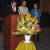 SHS teacher John Gildea announces the scholarship awards with Casey's parents, Joel Feldman and Dianne Anderson.