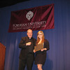 Stefanie Wheeler receiving the award from Rev. Michael Tueth, S.J.