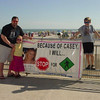 Dan, Madison and Matthew Martin from the Limerick, Pa. area (friends of Rachael Ceffaratti) pose by a banner while Mrs.Joy Martin takes their picture. This photo was taken on the Boardwalk at 9th St. in Ocean City.