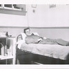 Lloyd Lantz on his bed in barracks.