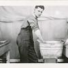Lloyd Lantz doing laundry in barracks