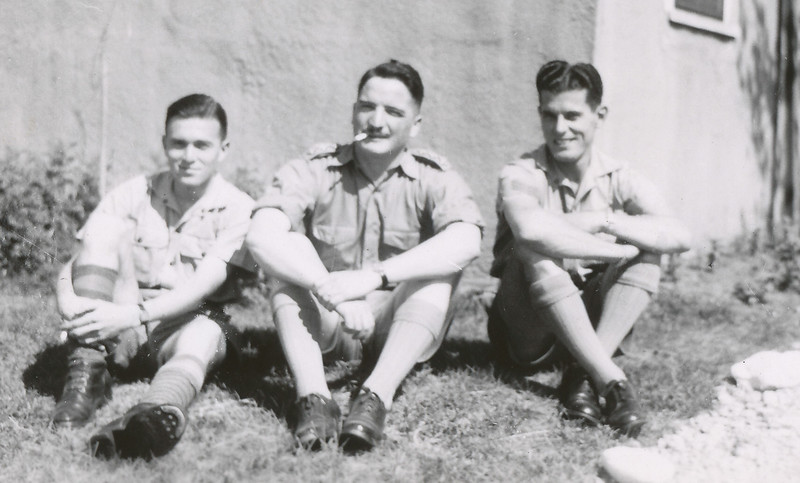 Lloyd Lantz sitting with two other soldiers