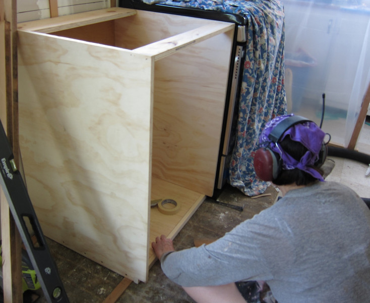 """Our """"carpentress"""" building the cabinet for fridge #1."""