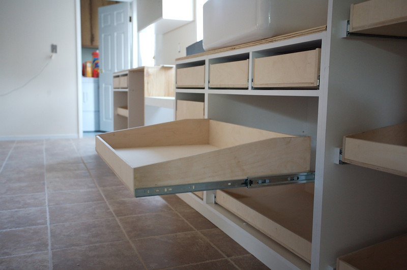 Drawers pull out all the way.<br /> Even extend out of the cabinet itself.
