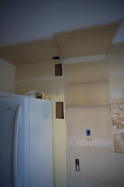 They relocated the water line for the fridge so that it actually came out of the back of the wall instead of dropped down from the ceiling.<br /> <br /> The original kitchen was a real hack job.<br /> <br /> Speaking of fridges, this one will be relocated to the garage once our new one comes in.