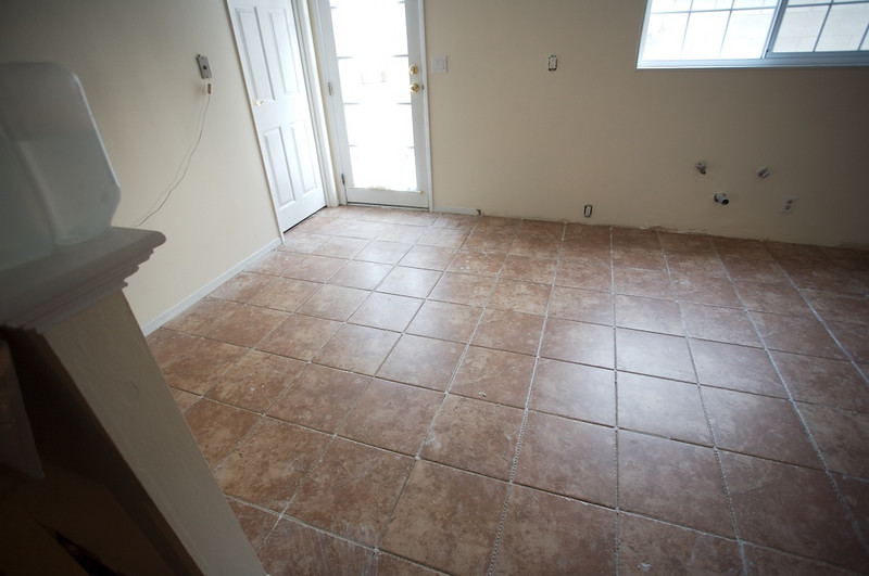 Tile set in the kitchen -- but not grouted yet.