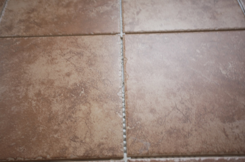 Close up of the tile. Edges are chipped. This should look good grouted.