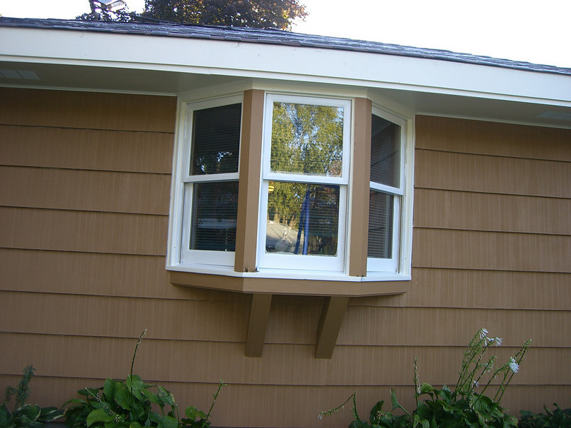 The storm windows for these windows have to be painted. Should they be painted the brown, orange, or cream?