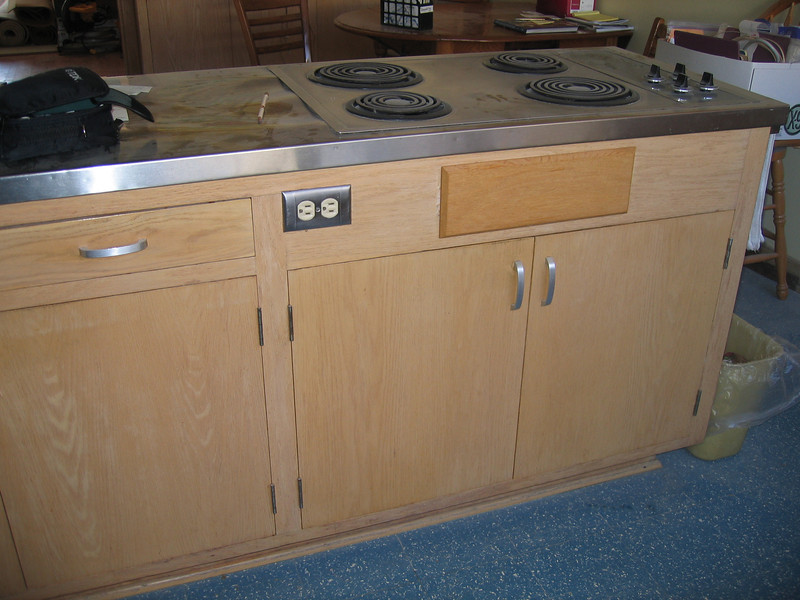 Old kitchen island will be replaced in order to accommodate a full size oven and to make a larger top so there is room for counter stools.