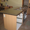 New island stainless top installed along with cooktop and oven.