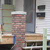 Closer view of brick piers for porch near kitchen entry.