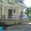 View from the street. Porch/deck will wrap around from front door to side/kitchen door.