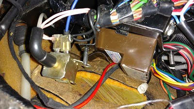 Amplifier is held in place with a large spring clip