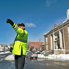Leominster Officer Brian Fitzgerald directs traffic around West Street next to Monument Square as the DPW cleans up the snow on Thursday morning. SENTINEL & ENTERPRISE/JOHN LOVE