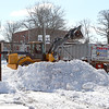 Leominster DPW works on clean up the snow on West Street next to Monument Square on Thursday morning. SENTINEL & ENTERPRISE/JOHN LOVE