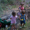 Cousins playing in the dirt