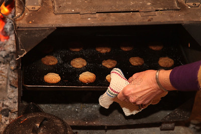 Cookies coming out of a fireplace reflector over, at the Pioneer Days festival in Fowler Park near Terre Haute, IN.