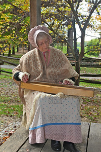 Judy Fortune playing a Mountain Dulcimer, at the Pioneer Days festival in Fowler Park near Terre Haute, IN.
