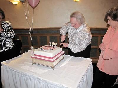 Nan cuts the cake