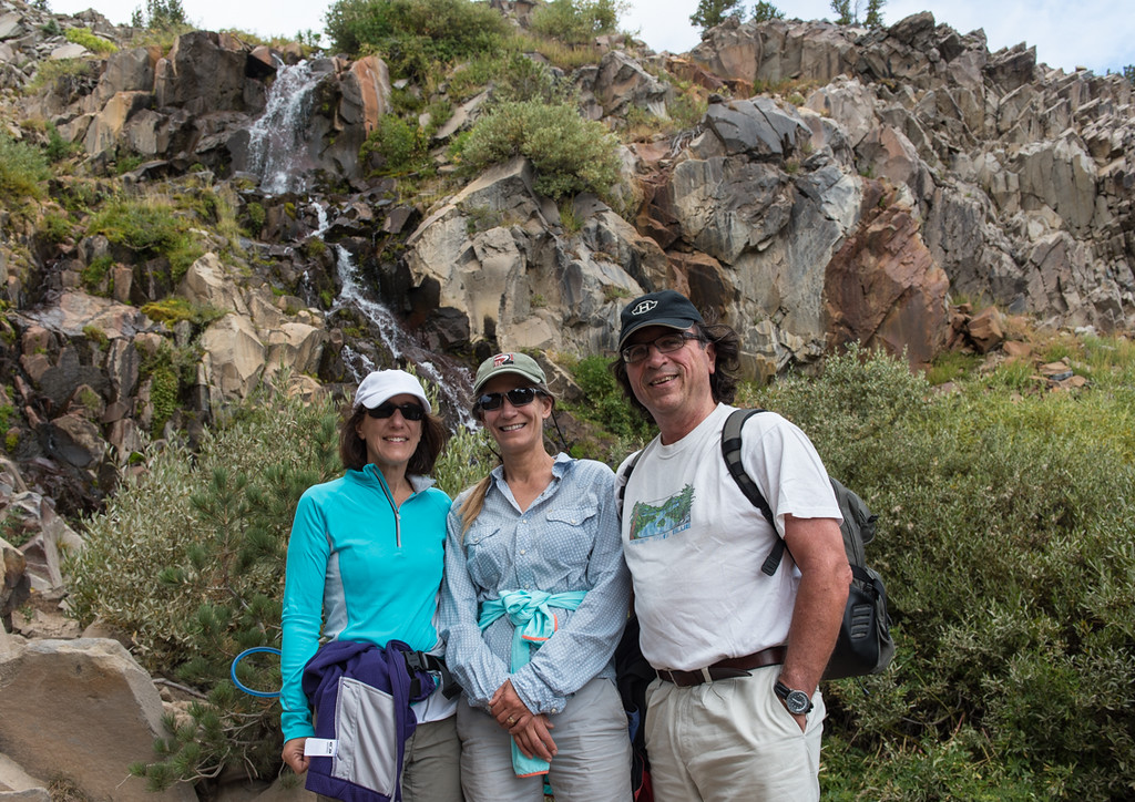 Lisa, Sally and Lorenzo posing at the waterfall. Still pretty early in the hike, all hats and glasses accounted for!