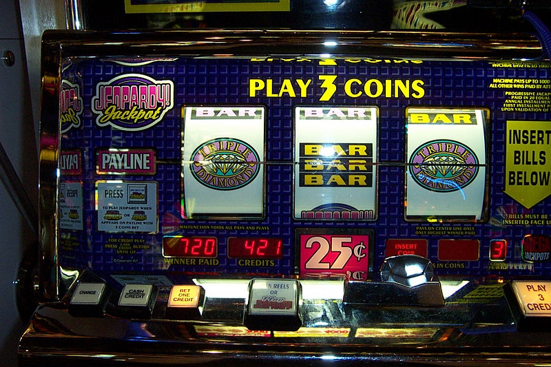 And this one was my biggest win on the trip!  Each of those symbols was a tripler, so having two meant the prize was multiplied by nine.  For this one spin I won 720 quarters, or $180.00!!!  Woo-hoo!!<br /> [Reno]