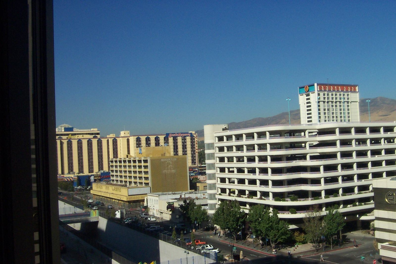 The Sands (larger yellow building at left) and the former Sundowner tower rising behind Eldorado's parking garage.<br /> [Reno]