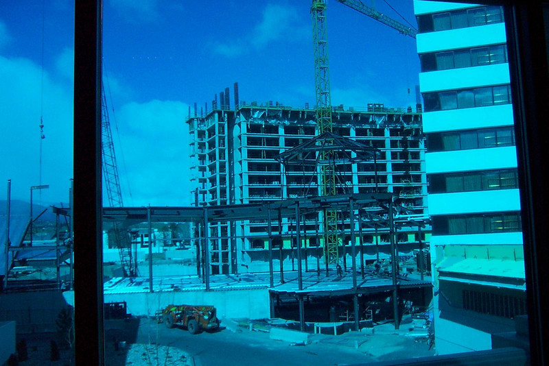 This is the new Tuscan hotel tower they're building (seen through tinted glass on the skybridge to the Peppermill's garage).<br /> [Reno]