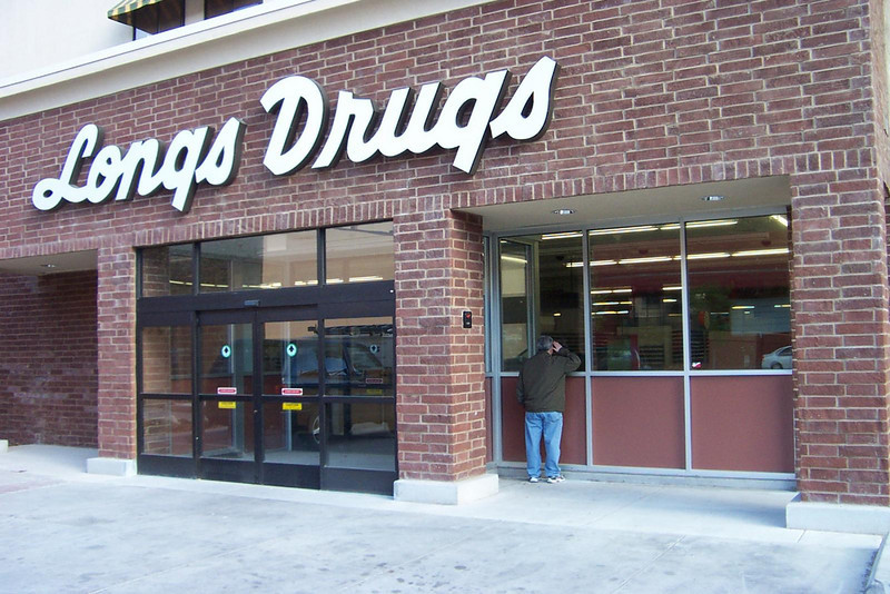 Dave peers into the not-quite-opened Longs Drugs which is in the former Showboat Casino building.<br /> [Reno]