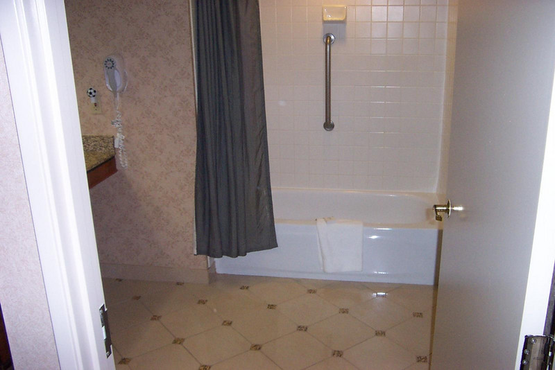 It's hard to tell in the photo, but there was about four feet between the end of the opened door and the bath tub in my handicapped-accessible room at Harrah's.<br /> [Reno]