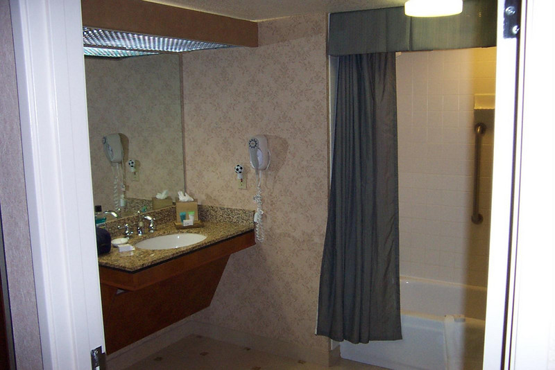 The most noticeable difference between our rooms at Harrah's was the enormous bathroom in my handicapped-accessible room!! You could easily host a party for 10 or 12 people in there!  :-)  On the downside, the overall square footage of the room was the same as a standard room.  That meant the area with the beds was smaller to make up for the increased space in the bathroom.<br /> [Reno]
