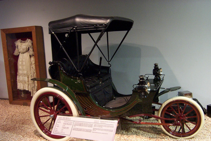 Here's a three-wheeled 1903 Duryea. As you can see, they also display period clothes and artifacts around the cars to give them some historical context.<br /> [Reno - National Automobile Museum]