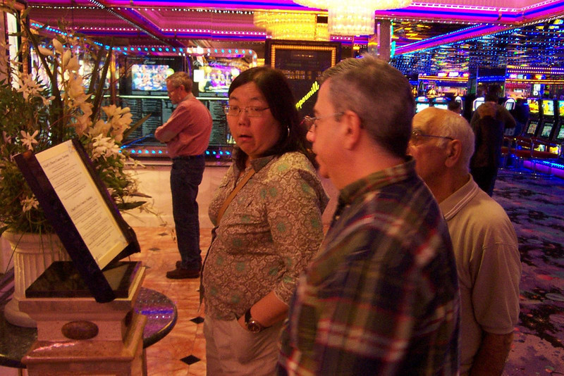 Kay, Dave and Lou check out the menu of the Peppermill's upscale restaurant.  Given the prices, and the fact we were still stuffed from the buffet, we kept walking!<br /> [Reno]