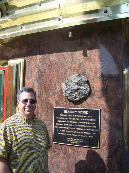 Dave poses with the piece of the Blarney Stone embedded in the wall outside Fitzgeralds.<br /> [Reno]