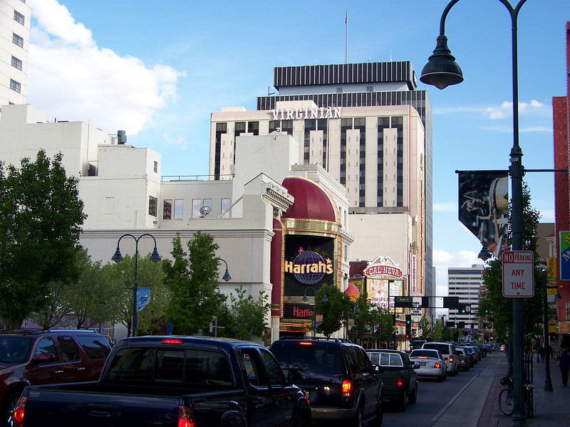 Dave, Lou and I all had rooms at Harrah's (their marquee is seen here on the left).  This is busy Virginia Street, Reno's main drag, looking south from right under the famous arch.  Let's go on a little walking tour of the area.<br /> [Reno]
