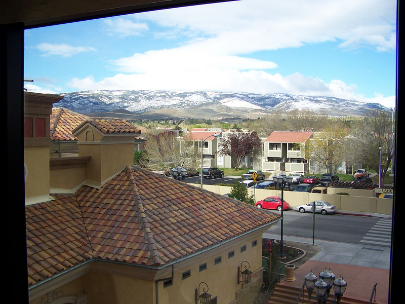 This is the view from my room.  I was on the fifth floor, but some of those floors must have been below grade.  It barely felt like I was above the street level on this side.  I had a nice view of the Sierra Nevada Mountains, though!<br /> [Reno - Peppermill Hotel Tuscan Tower]