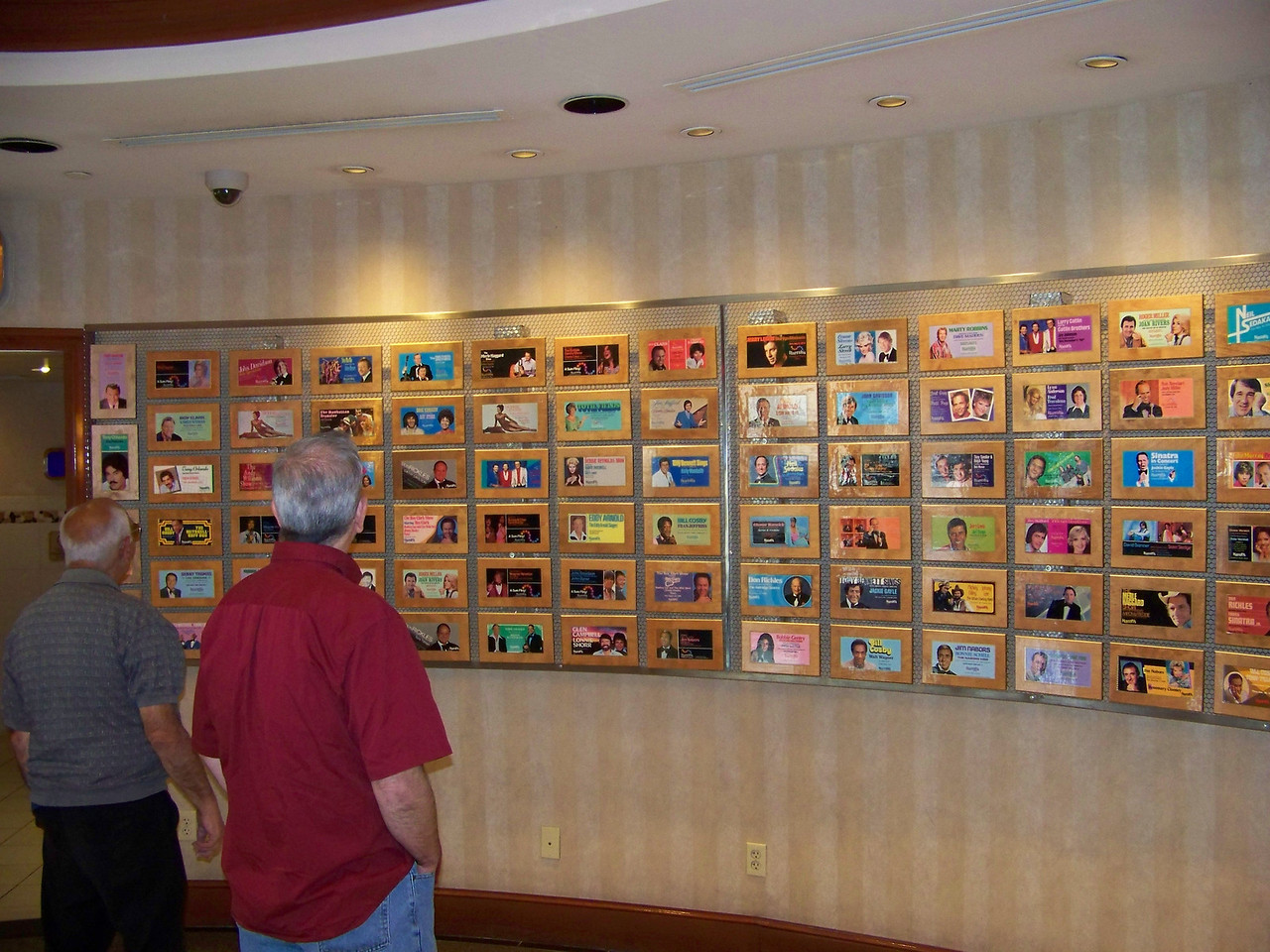 Dave and Lou look over a display outside Sammy's Showroom featuring the acts that have played at Harrah's over the years.<br /> [Reno]