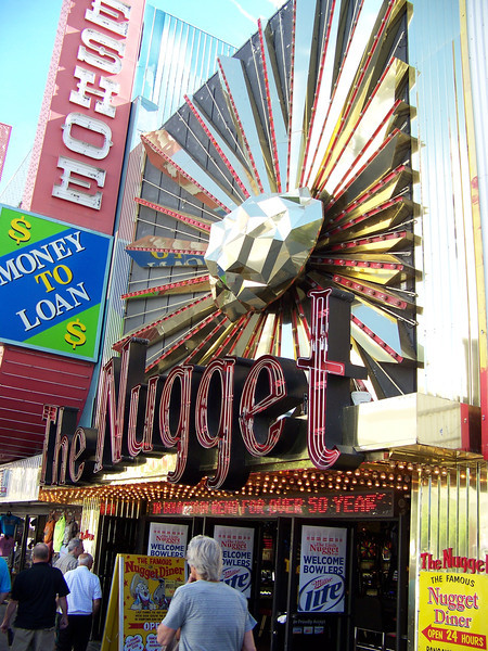 Directly west of Harrah's (across Virginia Street) is The Nugget casino.  When I first came here in the early 1990s, there were about five smaller, storefront casinos (without a hotel) on this block.  The Nugget is the last one remaining.<br /> [Reno]
