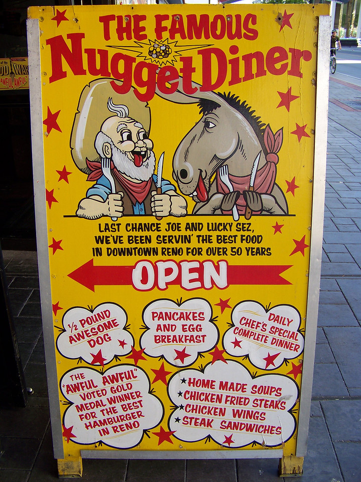 """Instead of a hotel, The Nugget has a very good diner in the back of the casino.  They're famous for the """"Awful Awful"""" (in the lower left of this sign).  It's a burger that's awful good, and awful big!<br /> [Reno]"""