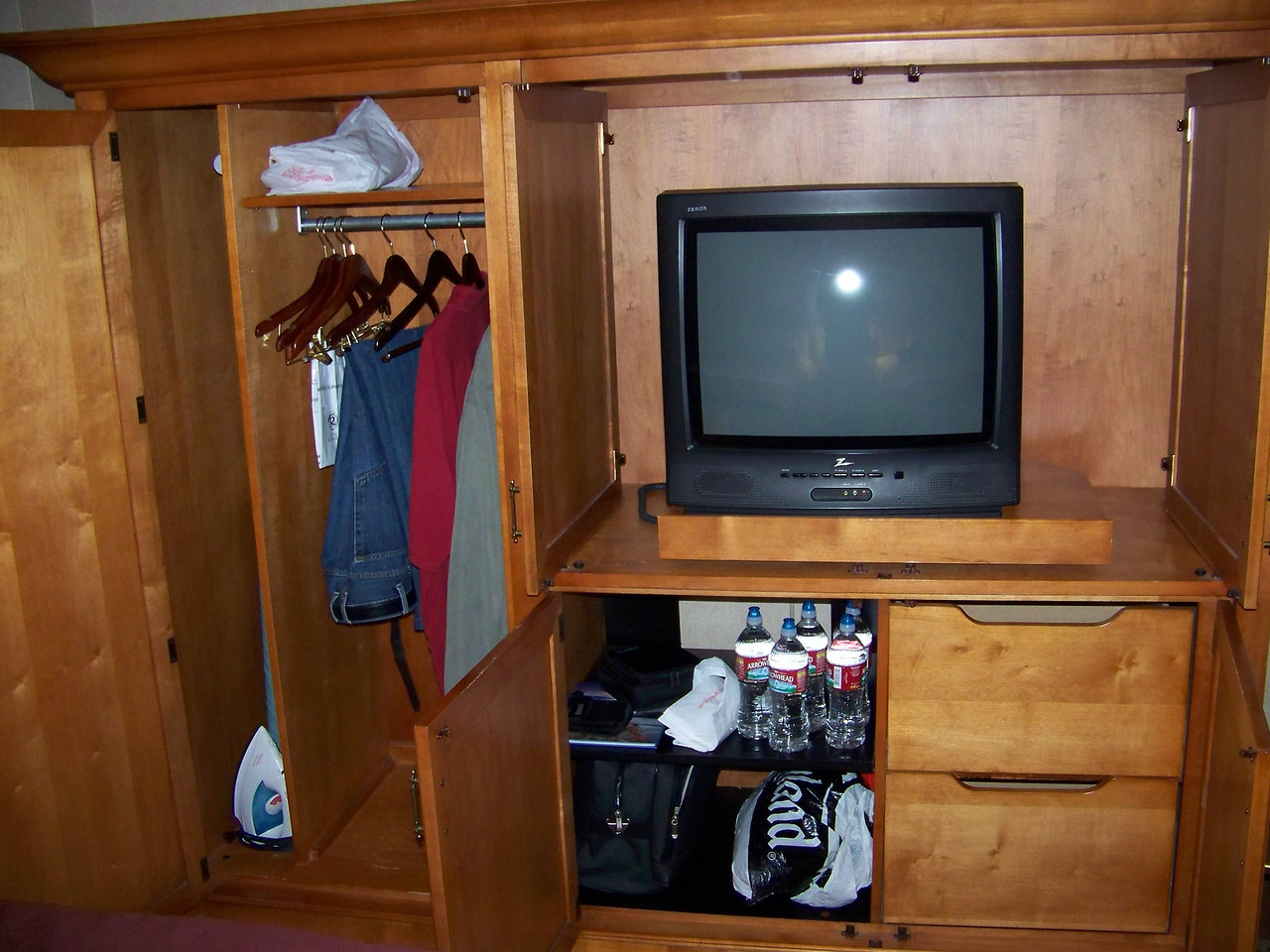"""The armoire is the only closet space, and also holds the TV.  The set in this room was disappointingly small--compare it to the TV in <b><a target=""""_new"""" href=""""http://triesch.smugmug.com/Reno/2007-April-15-21/3678020_RhX5ZJ#!i=210312690&k=WfBMtTm"""">this shot from one of our previous stays at Harrah's.</a></b> [Reno]"""