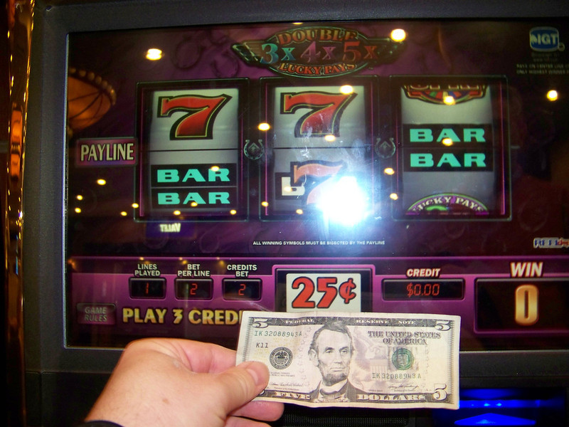 Here is the actual five dollar bill Jeff gave me, seconds before I fed it into the Wheel of Fortune machine.<br /> [Reno]